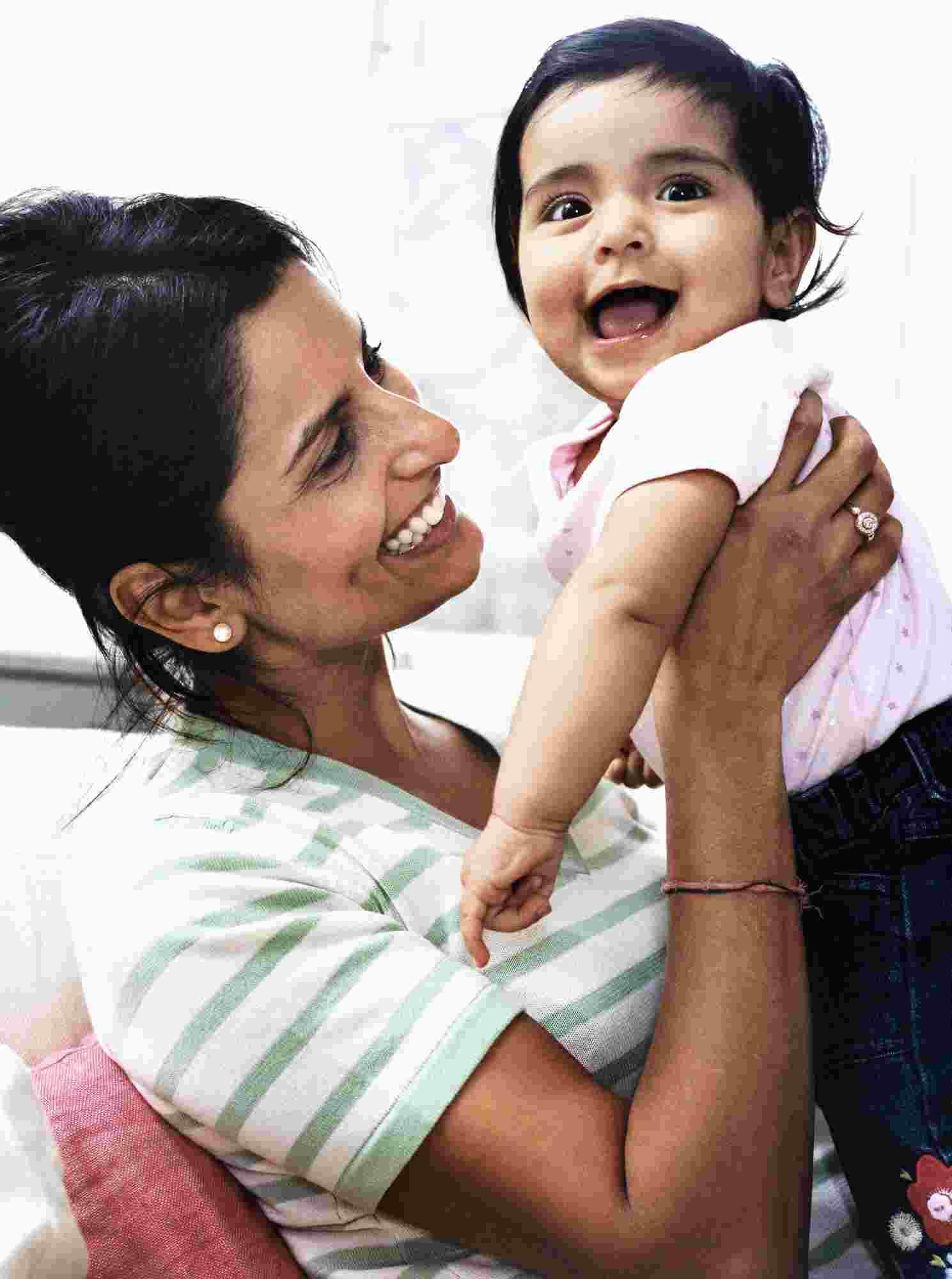 Mommy holding child